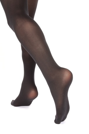 Woman legs wearing  tights  over white background photo