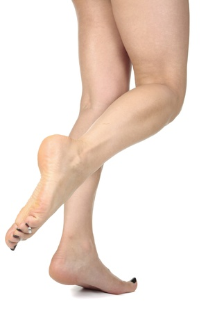 female feet: Woman legs isolated  over white background Stock Photo