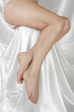 waxed: Woman legs over white background Stock Photo