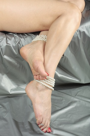 female feet: Female feet and legs wearing pearls