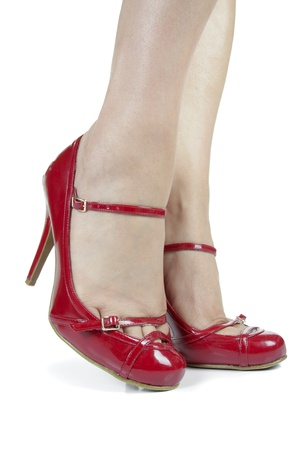 Woman feet wearing red heel shoes over white background Stock Photo - 13345391