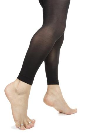 Frau Beine tragen footless schwarzen Strumpfhosen auf weißem Hintergrund Standard-Bild