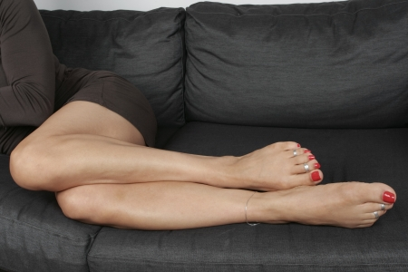 woman legs: Woman legs  relaxing sitting Stock Photo