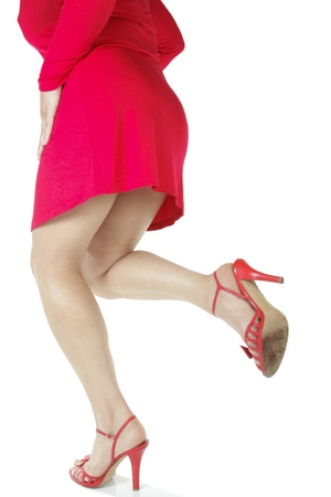 hold ups: Beautiful woman legs and red heel shoes  over white background Stock Photo