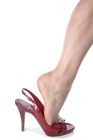 Woman feet wearing black heel shoes over white background Stock Photo - 16924263