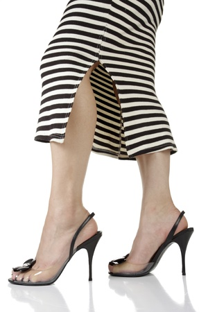black heels: Woman wearing dress and black heels over white background