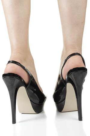 black heels: Woman wearing black  heels isolated over white background