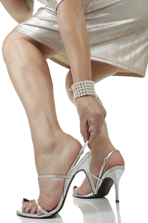 silver dress: Woman wearing silver dress and heels