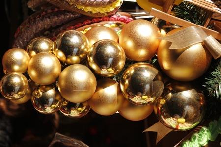 fantastical: decorative cluster of golden christmas balls -daylight spotlighted cluster of golden christmas tree balls