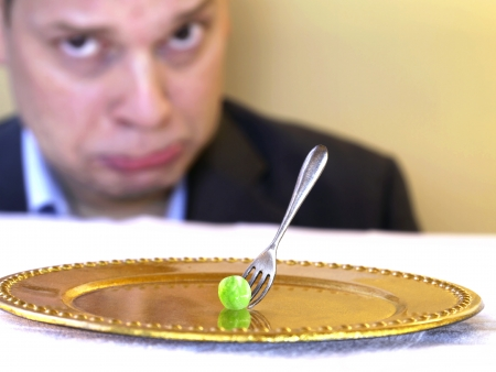 pea on golden plate photo