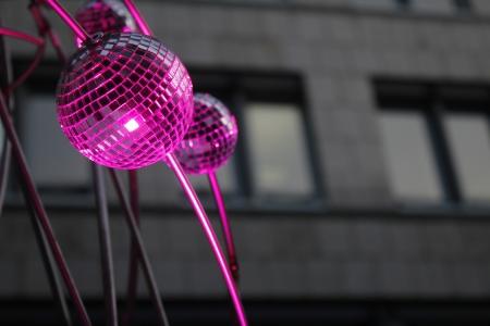 pink spotlighted mirror balls