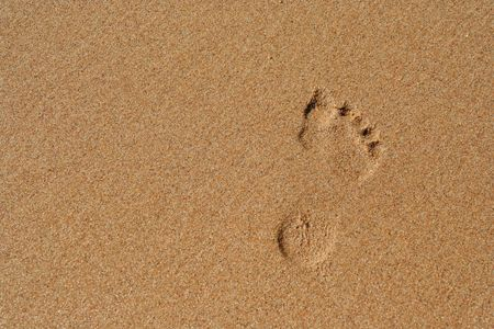 Bare footprint in smooth sand Stock Photo
