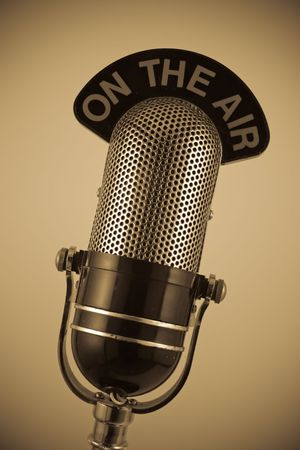 Vintage On the Air Microphone in sepia. Stock Photo