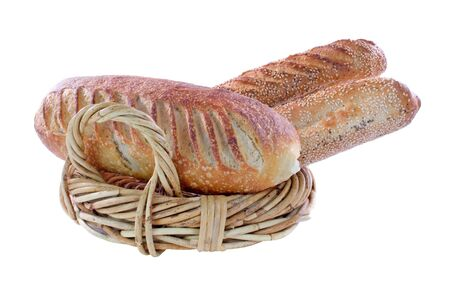 Sour dough bread in a wicker basket isolated on white  photo
