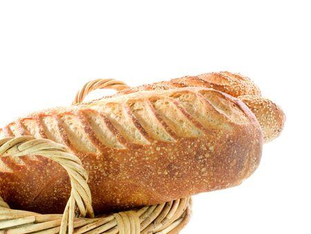 Sourdough bread in wicker basket on white  photo