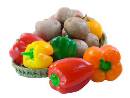 desiree: Basket of colorful capsicum, desiree potatoes and yellow squash on a white background