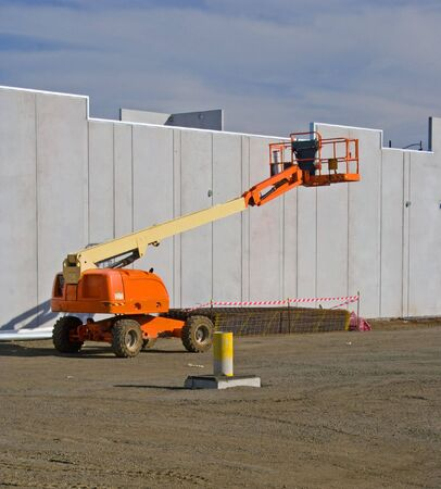 prefab: Elevated cherry picker on construction site