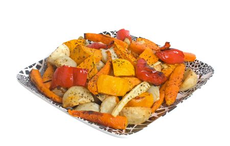 Oven Roasted Vegetables on china platter isolated over white background Stock Photo