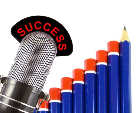 conveys: Success message on vintage microphone with graph of pencils in background.  This image conveys the concept of financial success in business.