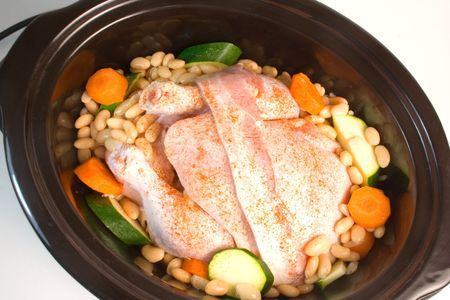 Fresh chicken prepared for cooking in a slow cooker.