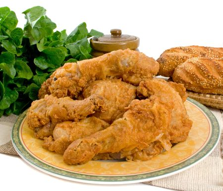 Fried chicken pieces over white background Stock Photo