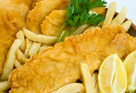 Freshly cooked Fish and Chips with Potato Cakes