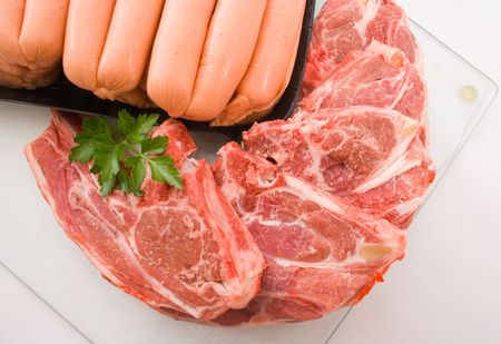Raw Lamb chops and Beef Sausages Stock Photo - 3691290