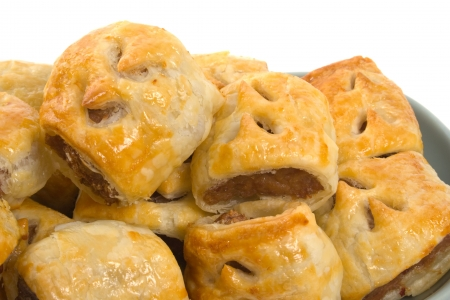 Close up image of freshly baked sausage rolls