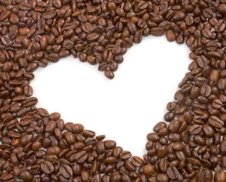 Heart shape surrounded by roasted coffee beans photo