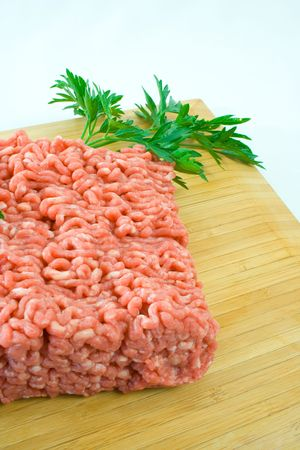 Fresh minced steak on chopping board Stock Photo