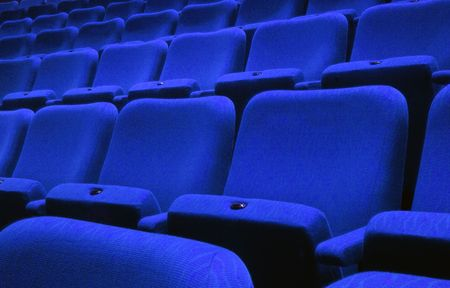 Rows of blue theatre seats