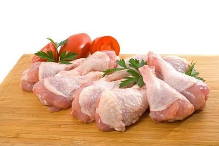 Fresh raw chicken wings on chopping board with roma tomatoes Stock Photo - 4665150