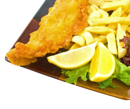 Fish and Chips on plate over white background photo