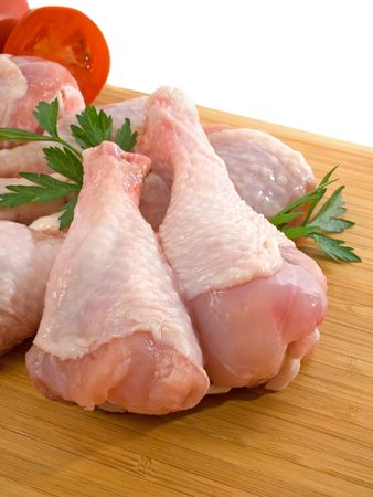 Fresh raw chicken legs on wooden board Stock Photo
