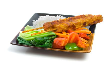 Chicken Satay Skewers with Bokchoy, capsicum, carrot strips and rice over white background Stock Photo