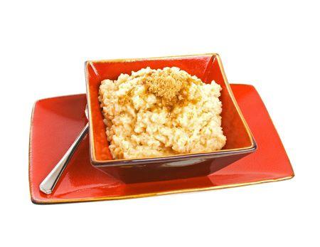 Delicious hot oatmeal porridge over white background. photo
