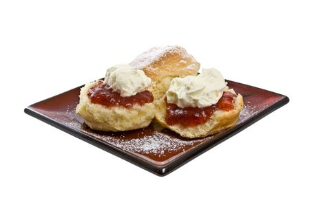 Scones with jam and cream on serving plate isolated over white background Stock Photo