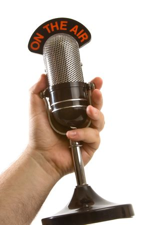 Retro On The Air Microphone held in hand over white background.