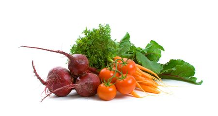 Beetroot, baby carrots and tomatoes isolated over white background. photo