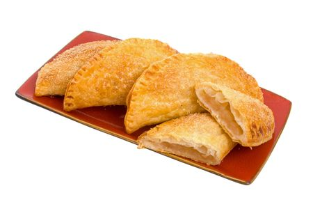 turnover: Selection of Apple Turnover Pastries on serving dish isolated over white background