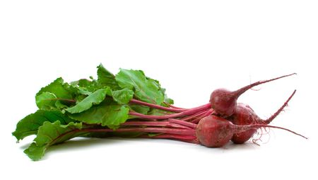 Three home grown beetroot with leaves isolated over white background Stock Photo