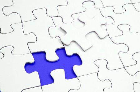 uncompleted: Jigsaw puzzle with a missing piece