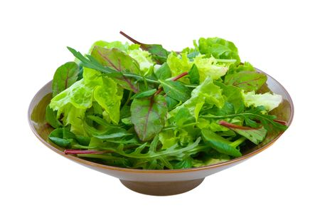 green's: Fresh mixed salad greens in serving bowl isolated over white background. Stock Photo