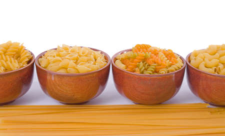 Selection of dry pasta over white background photo
