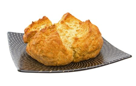 Delicious freshly baked Australian Damper Loaf over white background