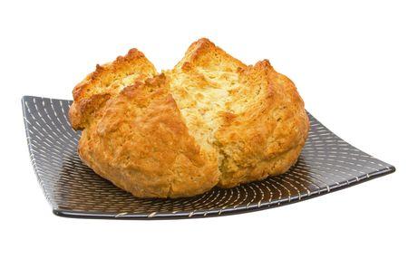 Delicious freshly baked Australian Damper Loaf over white background