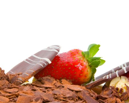 Close up image of strawberry decoration on a chocolate celebration cake isolated over white background. photo