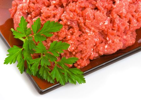 lean over: Lean minced steak on plate isolated over white background Stock Photo