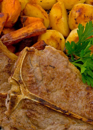 Close up of T-Bone steak with baked vegetables . Stock Photo - 4991971