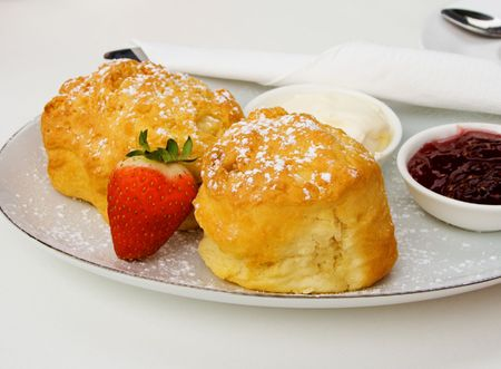 Delicious fresh devonshire scones served with strawberry jam and cream. photo